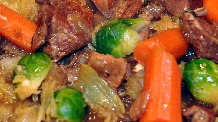 Chef John's Irish Pork Stew = This flavorful pork stew is made with cubed pork shoulder, dark beer, caraway seed, and Brussels sprouts. Serve over mashed potatoes.