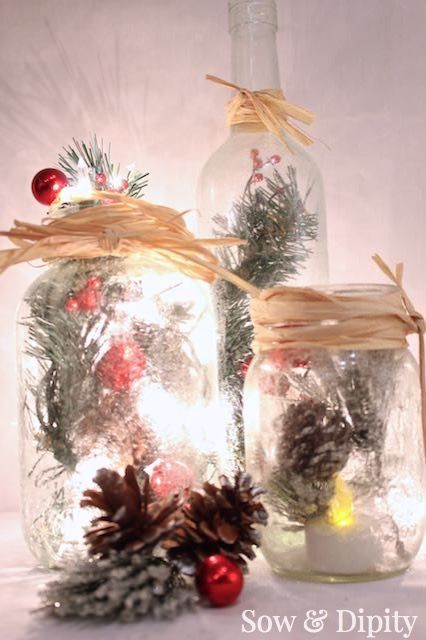 Frosted Mason Jars- Upcycle wine bottles and mason jars into a pretty illuminaire with these simple instructions. Perfect Christmas decor to set the mood!