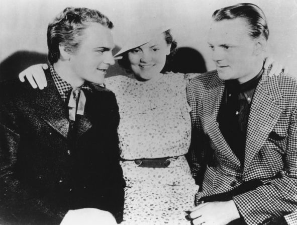 Born the youngest of 5 and the only girl, actress Jeanne Cagney is flanked by 2 of her 4 older brothers actors James Cagney and William J. Cagney.