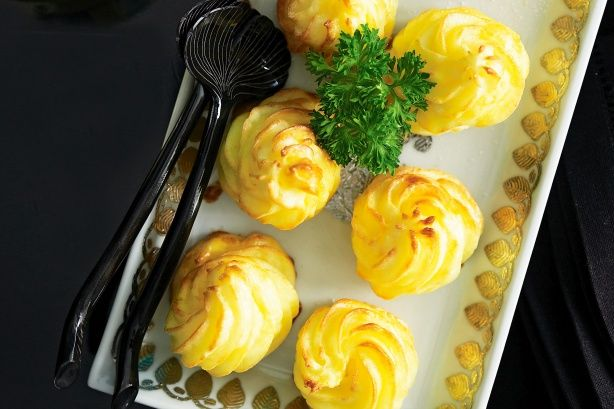 This is simply the royalty of side dishes - smooth mash potatoes shaped into attractive rosettes.