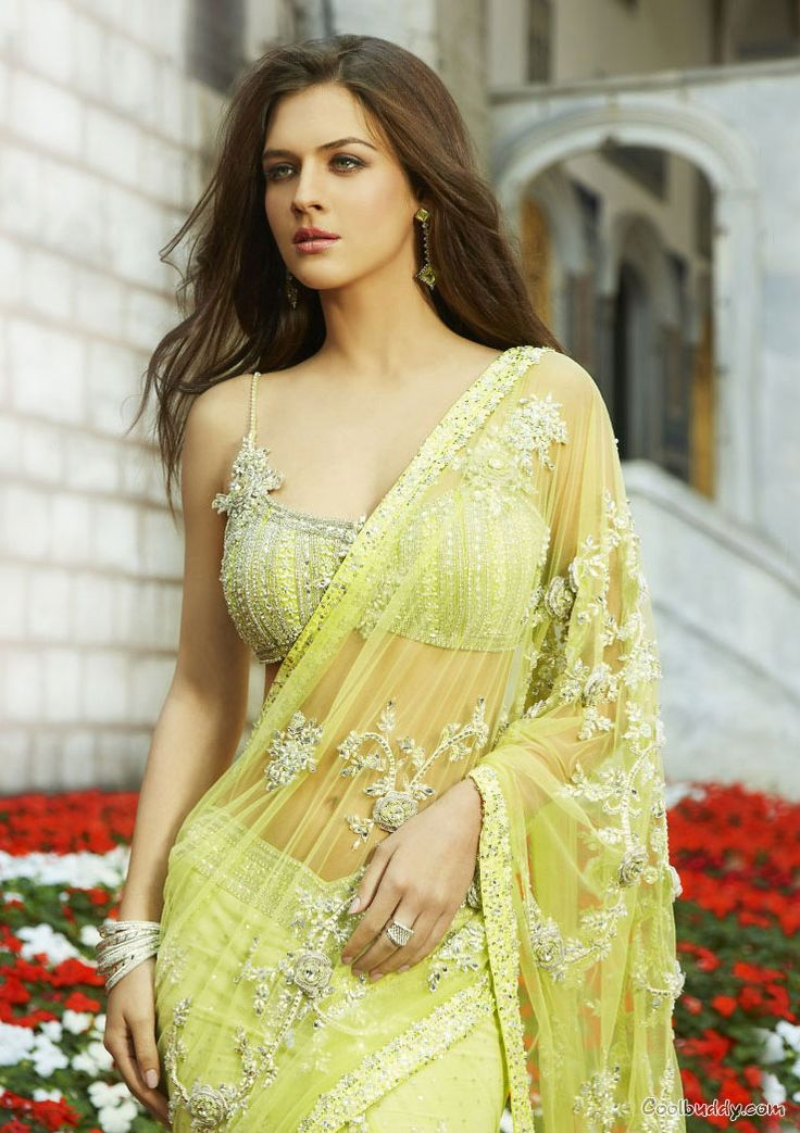 Bright yellow Saree with Embellished Blouse (Source: Unknown) @ http://www.ModernRani.com