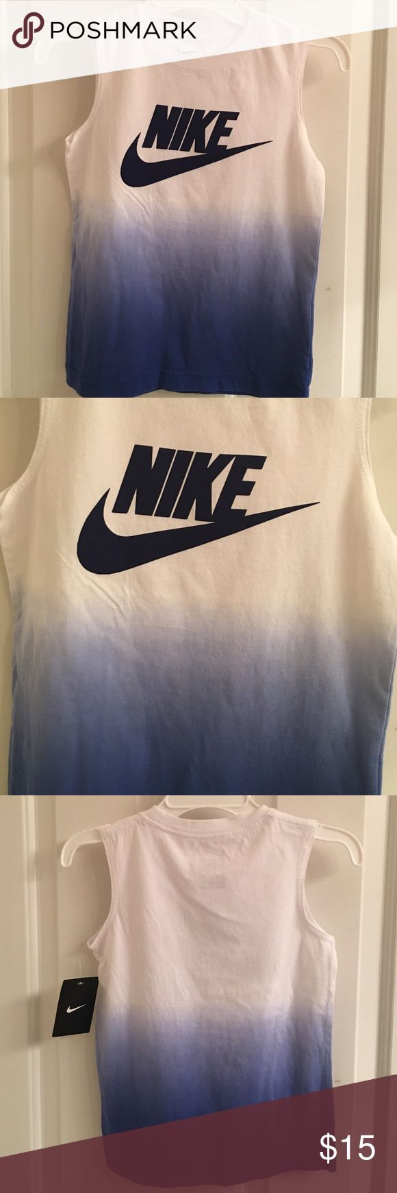 NWT- Nike Blue And White Tee-Shirt NWT- Nike sleeveless tee-shirt. Crewneck. White and blue, with Nike in black on the front. Size 6. Excellent condition. Nike Shirts & Tops Tank Tops