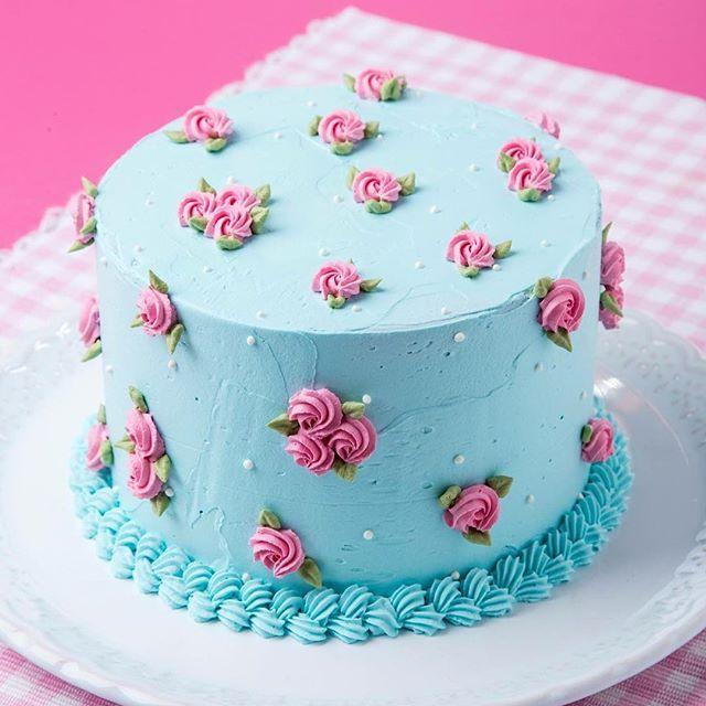 Pink and blue buttercream rosette cake