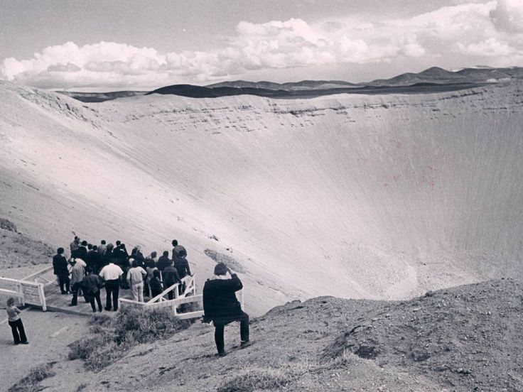 A 100 ton nuclear bomb created this 1,380 foot hole in the desert of Nevada during Project Sedan. The detonation was supposed to test the feasibility of nuclear bombs as excavation tools. Obviously, they work just fine.