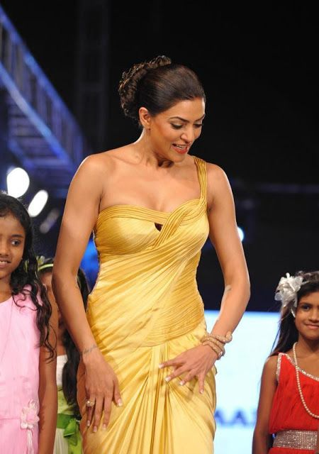 Sushmita Sen in One Shoulder Gold Evening Gown at 5th Edition Of Charity Fashion Event
