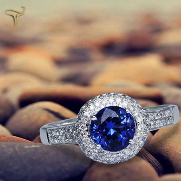 Magnificent #Tanzanite #Ring consists of an emerald cut tanzanite of around 1.10 carats enclosed withdiamonds, some encrusted on the band made of white gold.