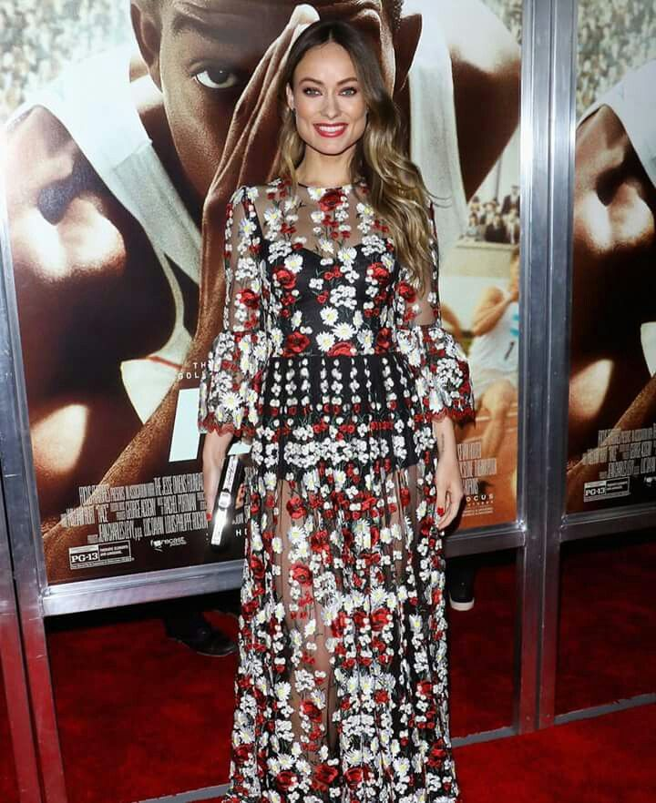 Olivia Wilde is wearing Dolce & Gabbana: Transparencies and Floral Patterned with Daisies and Poppies. Spring-Summer 2016.