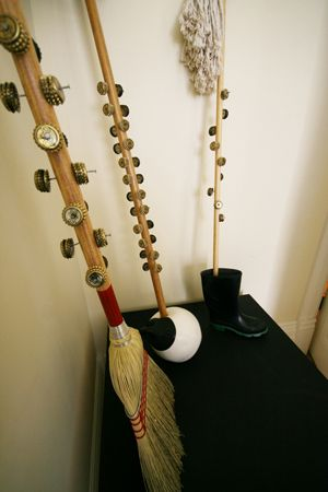 "Often found at traditional newfoundland kitchen parties, the ""ugly stick"" is a homemade percussion instrument crafted from household items."