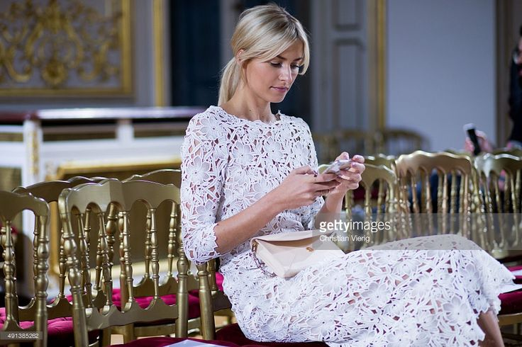 Lena Gercke checks her smartphone prior the Kaviar Gauche show as part of the Paris Fashion Week Womenswear Spring/Summer 2016 at Salon France-Ameriques on October 4, 2015 in Paris, France.