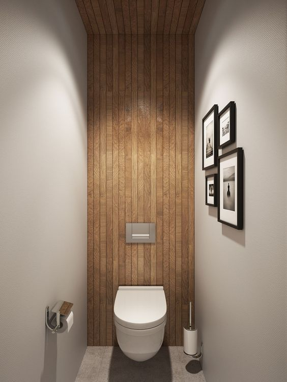 These thin strips of wood make elegant panelling. By using it along the height of the wall and up onto the ceiling, they make this small cloakroom look much more spacious.