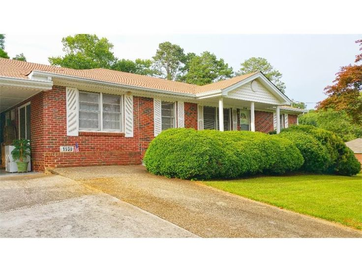 Perfect STARTER HOME or downsize to ONE LEVEL LIVING.! Awesome LOCATION!  Very well-MAINTAINED 4 sides BRICK Ranch on a LARGE LOT with lots of windows! Gorgeous very PRIVATE YARD with a plethora of room to PLAY and room for GARDENING and/or EXPANDING! HUGE front and side yards! FINISHED BONUS ROOM off carport, perfect for OFFICE, WORKSHOP or BUSINESS! Shopping, schools and major highways are so very close. TALL Crawl is great for STORAGE.  QUICK and EASY CLOSE!
