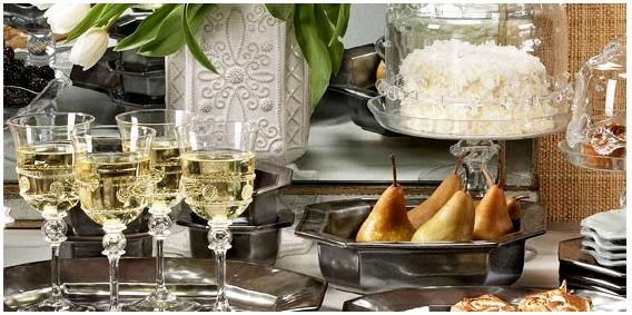 Michael Aram pewter dinnerware with Juliska glassware. I love this.