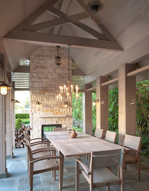 love the simple dining lighting and the fireplace..