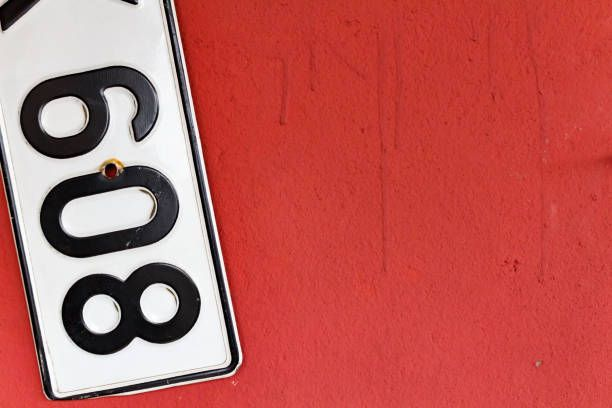 fragment of car registration numbers hanging on the wall abstract