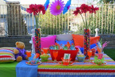 "Table setting for the girls' ""slumber party"" fifth birthday. love the skittles in the vase with flowers! :)"