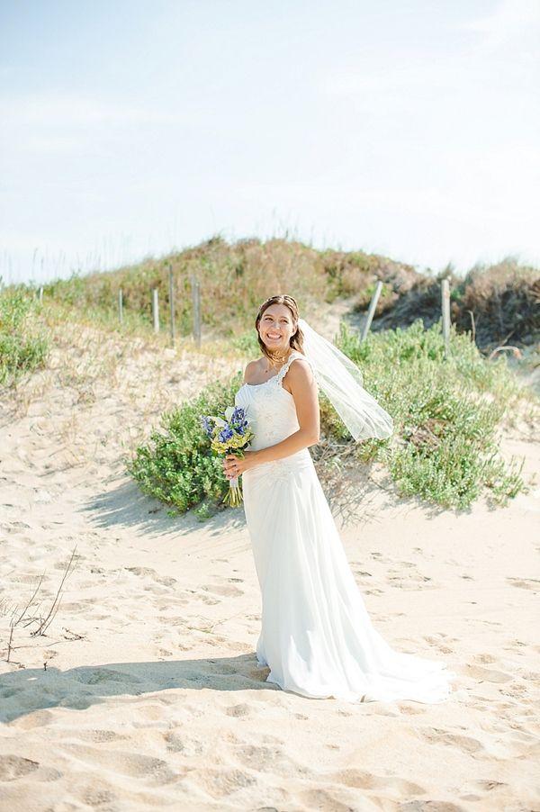 David's Bridal bride Michele in a one-shoulder chiffon wedding dress at her beach wedding.