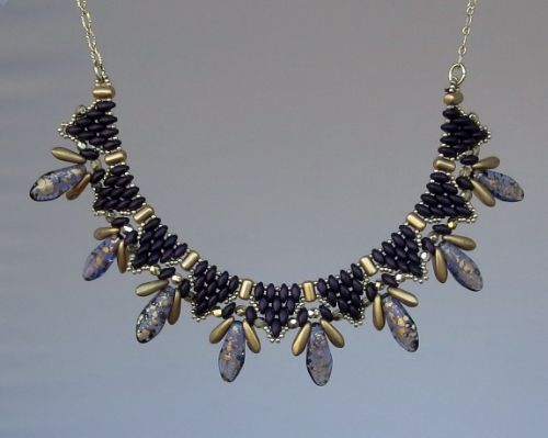 Sat. Nov. 28th @ 10:30 - On Point: Beginner Level. Utilize peyote stitch with Superduos to create a necklace separated by rullas, highlighted with daggers and 3mm fire polish, framed by 15º seed beads and finished with chain for a desired length.