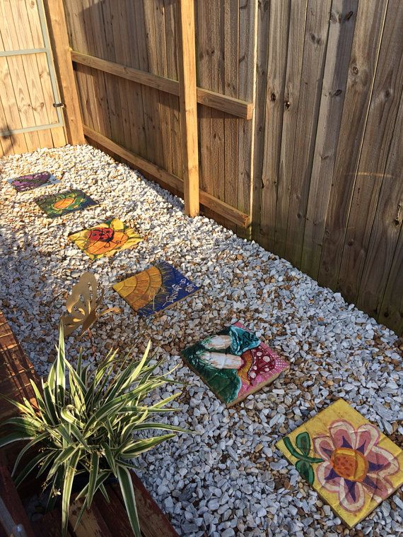 Hand painted stepping stonesSpring time theme by COMScreations