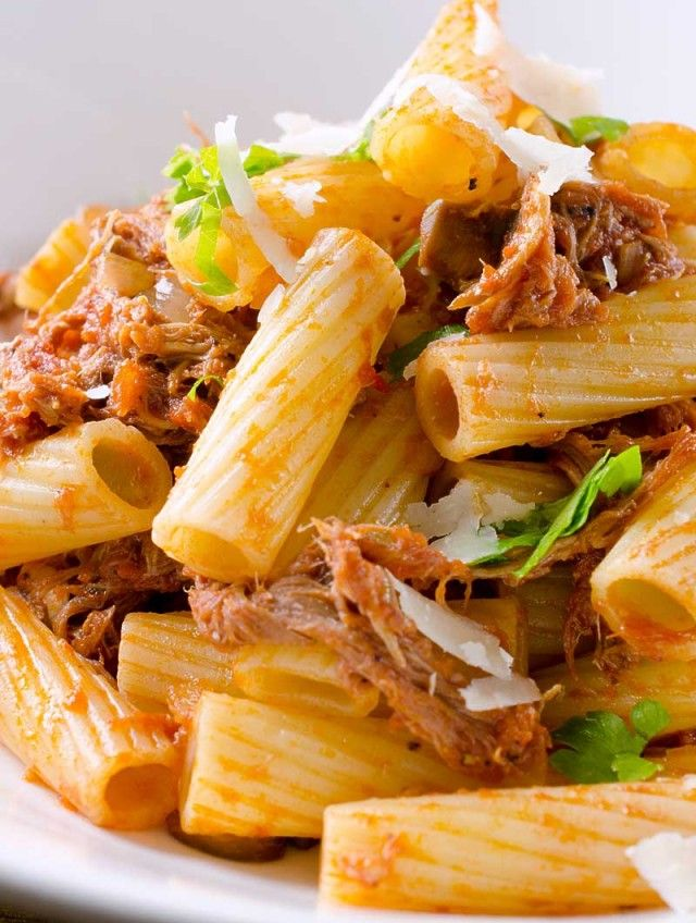 Rigatoni pasta tossed with a rustic tomato sauce of crushed tomatoes, pulled pork, onions, mushrooms and garlic.