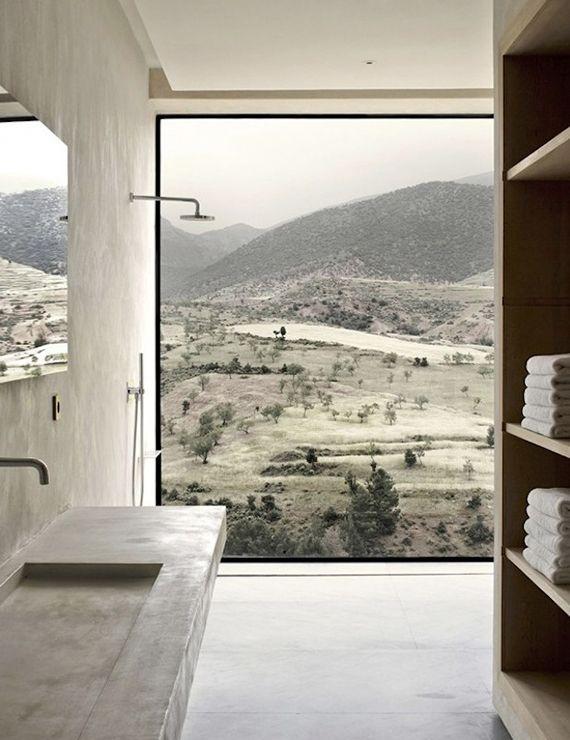 Contemporary concrete bathroom with mountain view by Studio Ko