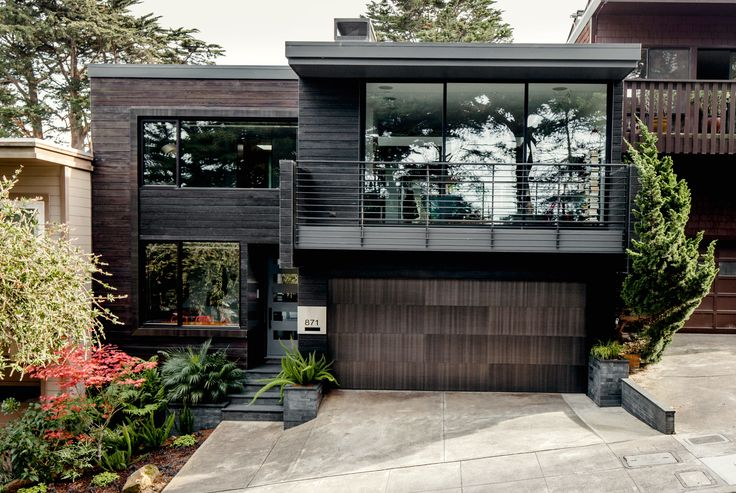 Scott MacFiggen and Regina Bustamante, tech industry veterans from Silicon Valley, called on architect Christi Azevedo to rebrand a fusty house in San Francisco's Noe Valley, starting with the street view. Cedar boards, charred using the Japanese technique shou sugi ban, replaced plywood siding.