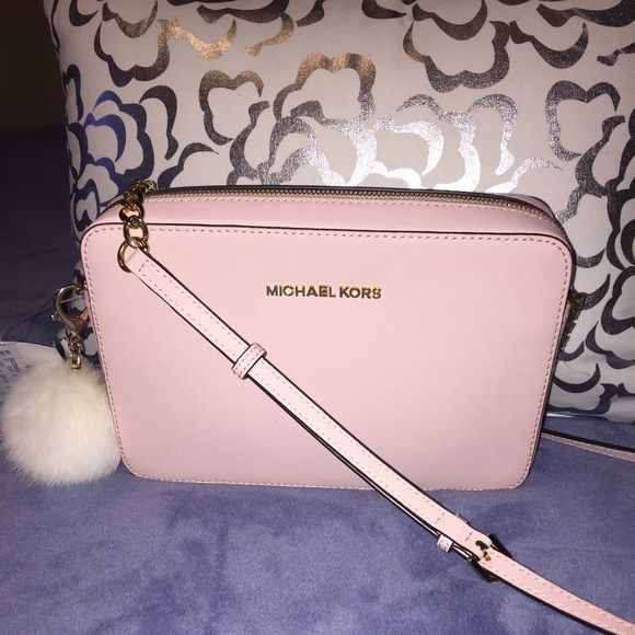Large Michael Kors cross body Light pink purse. Brand new with out tags. No trades. MICHAEL Michael Kors Bags Crossbody Bags