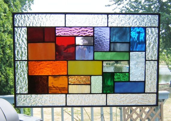 Stained glass panel rainbow geometric abstract stained glass window panel. $79.00, via Etsy.