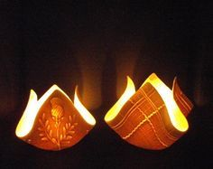 Tealights from Momentum Pottery in Scotland Recreate: Lay an imprinted square slab over an empty toilet paper roll