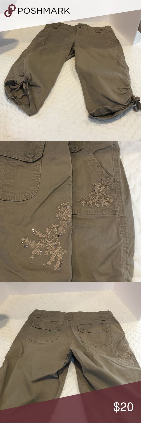 Gloria Vanderbilt khaki capris These capris are gently used. Khaki in color.  Decorative stitching and rhinestones of front and back. Gloria Vanderbilt Pants Capris