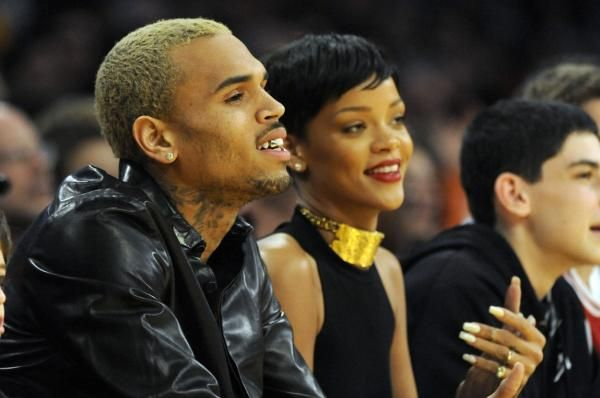 Chris Brown angered fans by leaving an emoji on a photo of Rihanna's outfit for the traditional festival in Barbados.