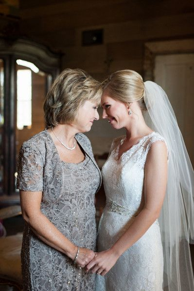 Mother + daughter wedding day photo idea - the mother of the bride + bride share a sweet moment before the wedding reception {Cotton + Clover Photography}