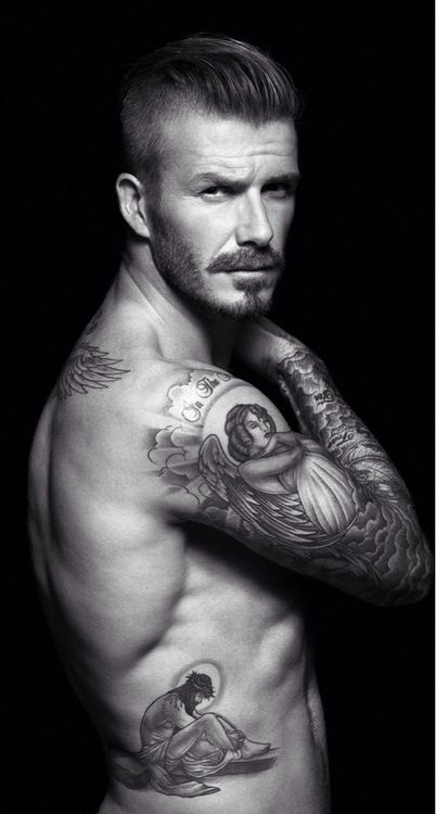 This man is so sexy. His body sweats hormones! David Beckham.