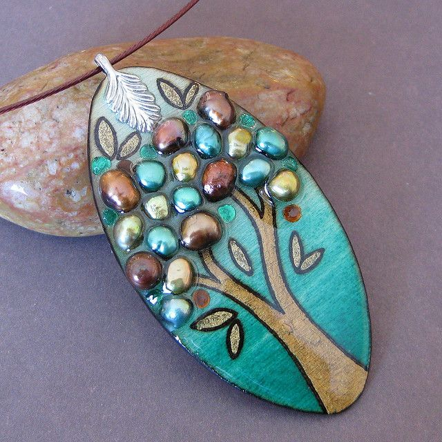 Wood burned, hand painted and adorned with freshwater pearls by Michelle Hambourg.