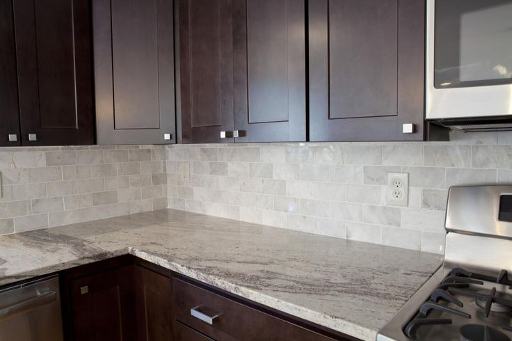 kitchen with granite backsplash meram carrara marble subway tile from the tile shop river 6513