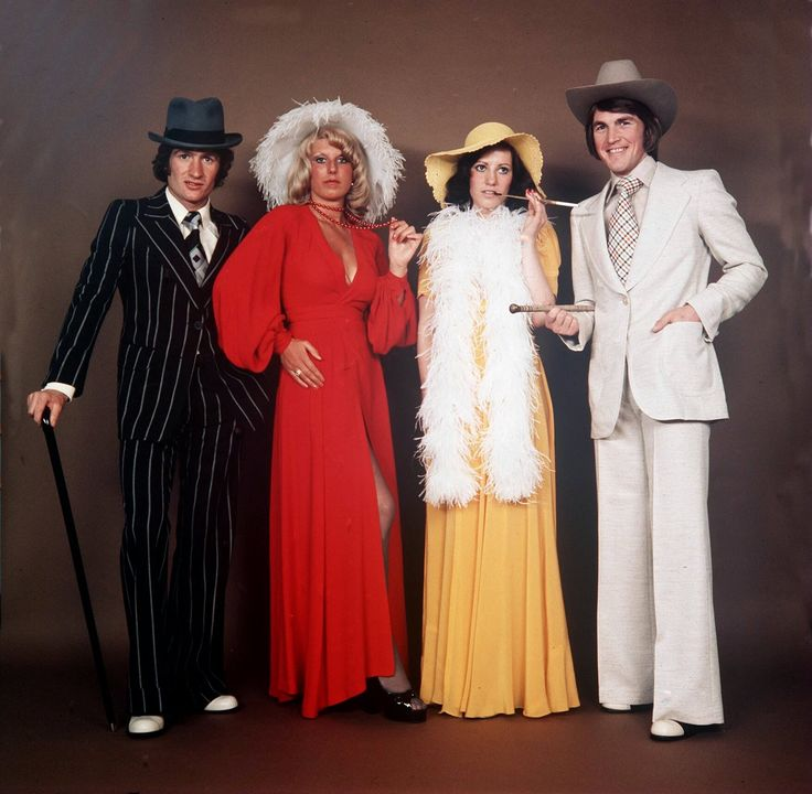 Scottish footballers Kenny Dalglish and Sandy Jardine, with their wives Marina and Shona, at a fancy dress ball. Glasgow, 1975.