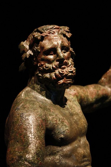 """Hercules (Heracles) (""""Epitrapeizos"""") - detail, Roman statue (bronze) modelled after Lysippus, 1st century AD (original 4th c. BC), (Museo Archeologico Nazionale, Naples)."""