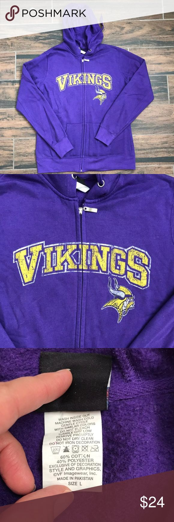 """🏈 Minnesota Vikings purple zip front hoodie Excellent condition zip front hoodie in a rich purple with a vintage look screen of the Vikings logo.  Fuzzy inside. This is not a heavy sweatshirt.  I only wore this once to go to the game and it has been folded in a cabinet since.  Size L (but fits like a medium) Bust when zipped 21"""" Full length sleeves Front pockets  See pic of tag for material content. Tops Sweatshirts & Hoodies"""