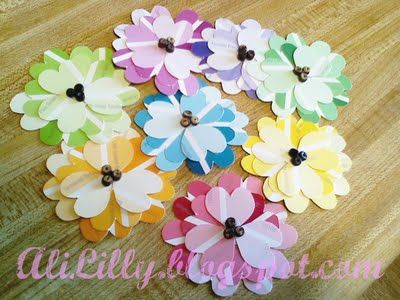 Flowers made from paint chip samples., when made into a  spring wreath.