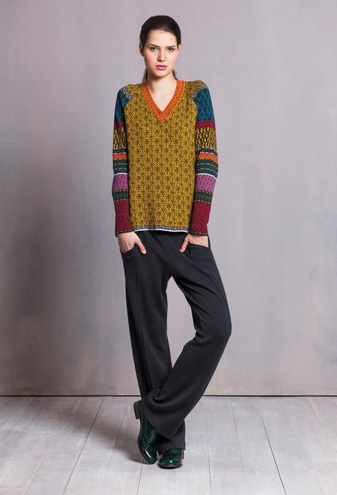 This cozy pullover with intricate geometric pattern reflects the changing taste in art at the time of 1960s.