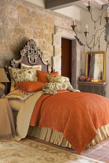 ...a touch of orange warms the room and looks fab with the stone