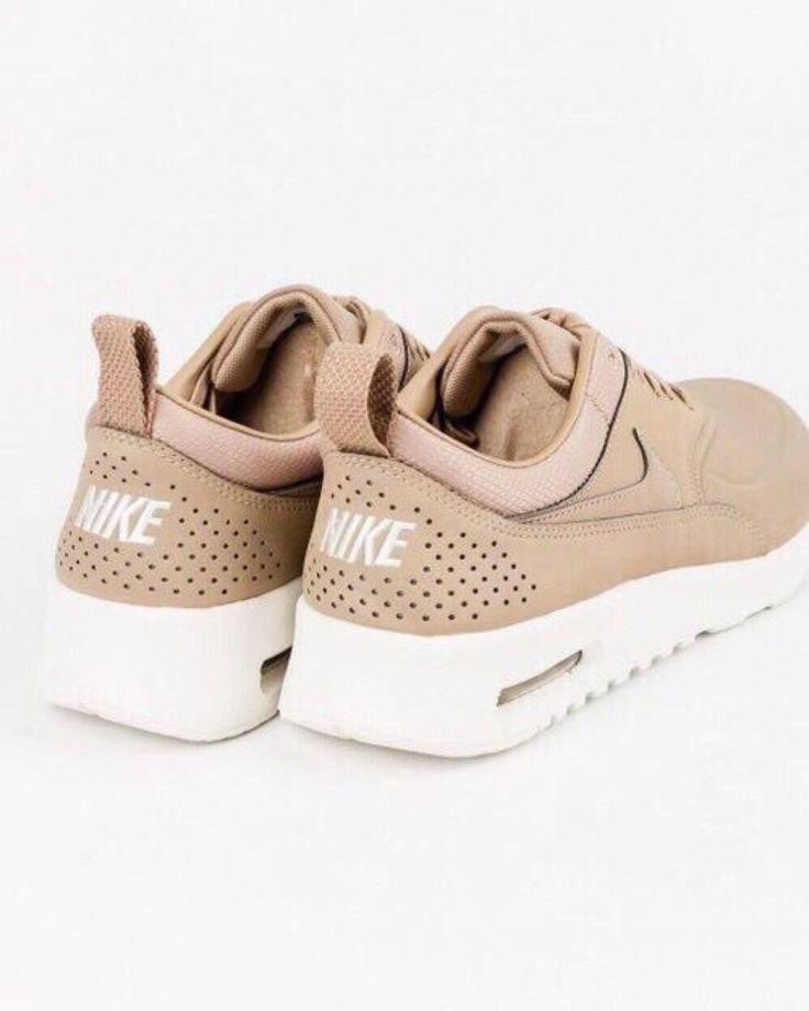 Tan Nikes.