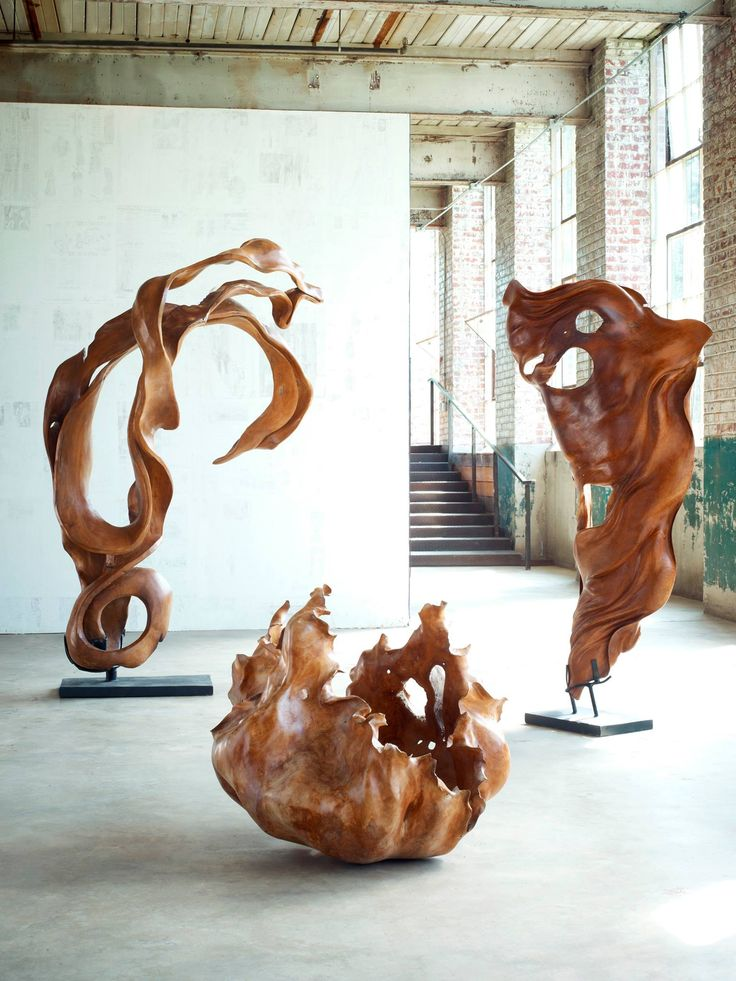 Phillips Collection  A new twist on reclamation, we seek out incredible roots from long-ago felled mahogany trees in Central Java, Indonesia and fashion them into works of art. The result is a collection of one-of-a-kind forms that can act as freestanding sculptures, all exquisitely carved and sanded. This not only brings to market extraordinary pieces crafted from sought after wood species but supports and sustains the local artisan communities where they are produced. Not a single tree is…