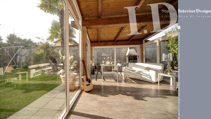 Veranda e giardino, villa nel milanese www.studiointeriordesign.it