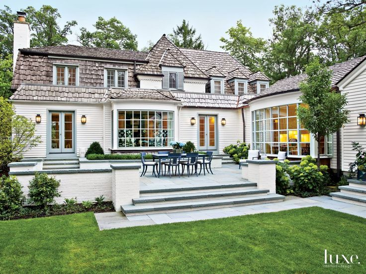 traditional white brick exterior with boxwoods luxesource luxe magazine - Luxury Homes Exterior Brick