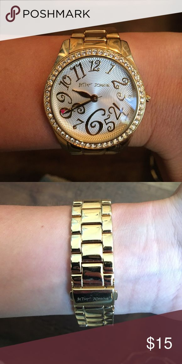 Betsey Johnson watch Gold colored watch! Cute little pink heart detail on the seconds hand! The watch turner on the side is a rose. The details on this watch are just too cute! The band has scratches on them but can only be seen if you look closely. ***does need a new battery though Betsey Johnson Accessories Watches