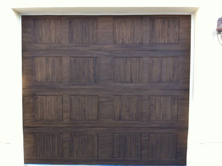 Aluminum garage doors painted to look like stained wood for Paint garage door to look like wood