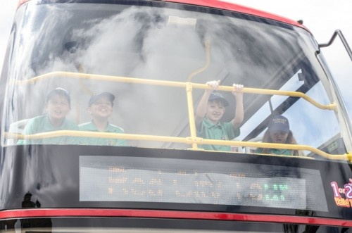 The Johannesburg City Sightseeing tour bus gives you a great view Johannesburg in a completely new way.     These Radford House students are sitting on the top level of the double decker open top bus in the front row.