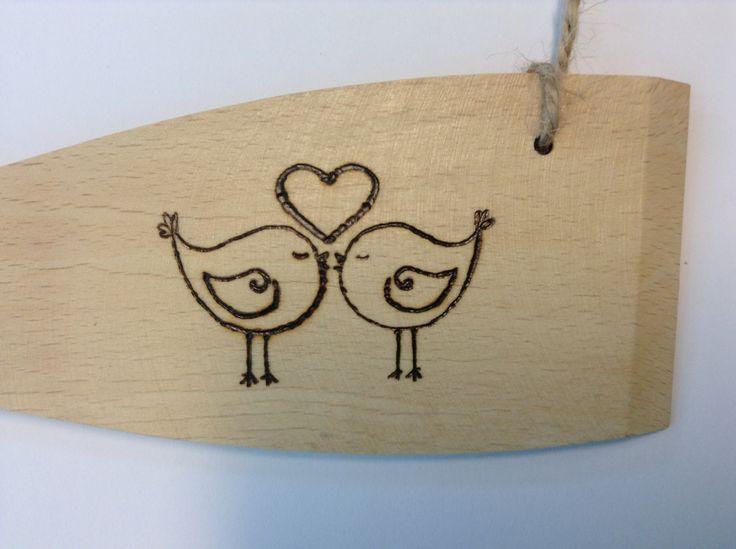 Woodburnt love birds