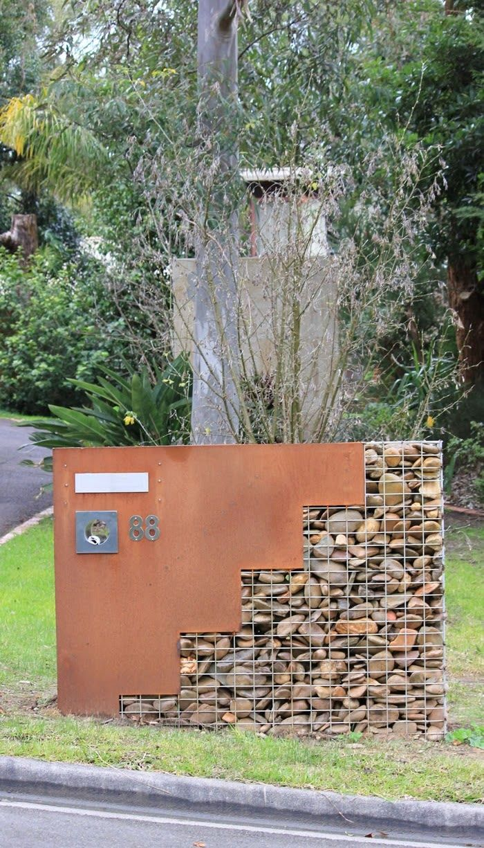 entry sign, corten steel with gabion stone