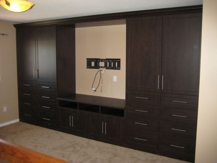 Wardrobe with tv stand california closets bedroom for Bedroom designs with tv unit